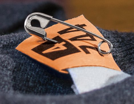 Dry Cleaning Tag with Safety Pin on Garment